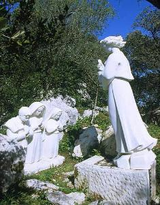 The apparition of the Angel to Lucia, Jacinta and Francisco.